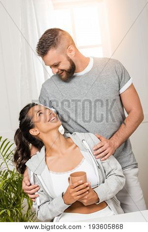 portrait of happy man and woman looking at each other
