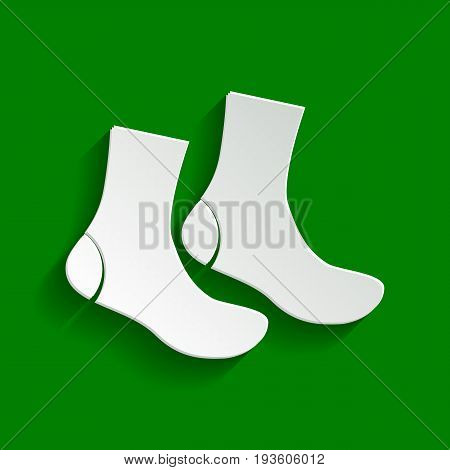 Socks sign. Vector. Paper whitish icon with soft shadow on green background.