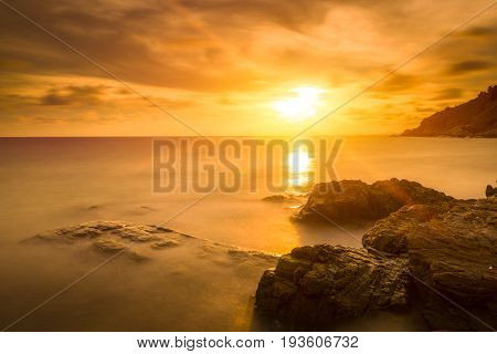 Silky sea and silky clouds during sunset about raining