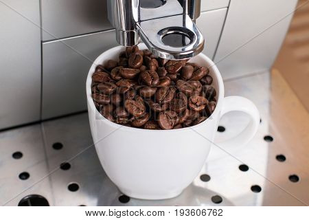 Coffee machine brewing a coffee on a metal stand