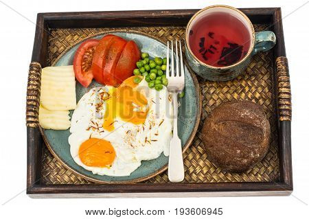 Breakfast. Wooden tray with dishes. Studio Photo