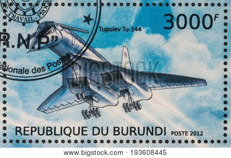 Moscow Russia - July 02 2017: A stamp printed in Burundi shows Soviet supersonic passenger airliner Tupolev Tu-144 series