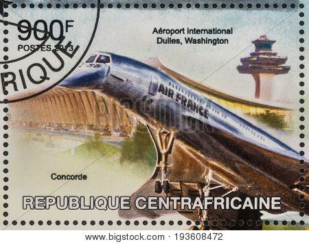 Moscow Russia - July 02 2017: A stamp printed in Central African Republic shows supersonic airliner Concorde in Dulles airport Washington series circa 2013
