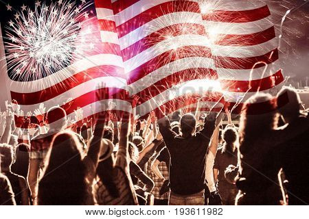 fireworks over United States flag - crowd celebrating 4th of July Independence Day