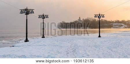 Snowy Embankment Along The Misty River With Lanterns At The Foggy Sunrise - Winter Landscape. Ii