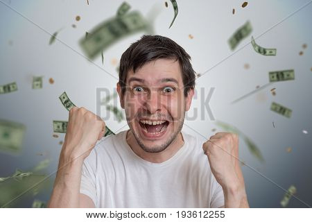 Young Happy Man Is Winner Of Lottery. Money Are Falling From Top