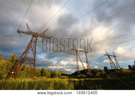 High-voltage Power Lines. Electricity Distribution At Sunset. High Voltage Electric Transmission Tow