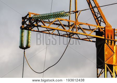 Electricity pylon detail view with grey clouds