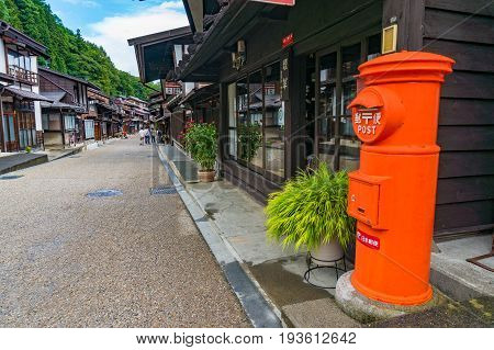 Bright Orange Japan Post Post Box On Narai Street. Kiso Valley