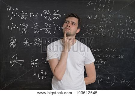 Young Student Is Thinking And Solving Mathematical Problem. Math