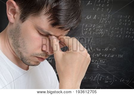 Young Man In Thinking. Solving A Difficult Math Problem. Math Fo