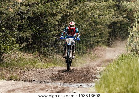 Kyshtym Russia - June 18 2017: enduro athlete rides on rear wheel of motorcycle during Ural Cup in Enduro
