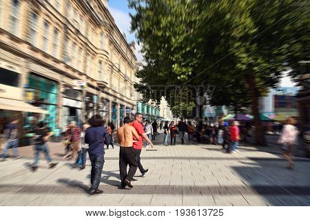 Cardiff, Wales, UK, September 14, 2016 :  People walking in the pedestrian precinct of Queen Street in the city centre with a zoom burst effect