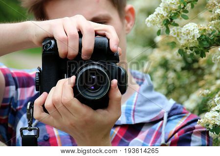 Portrait Of A Photographer Covering Her Face With The Slr Camera