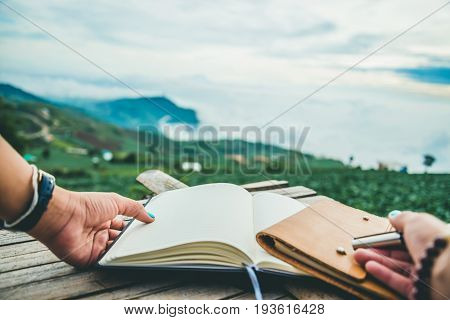 The woman hand holds the writings. Morning atmosphere The mountains are foggy. phetchabun phutubberg thailand