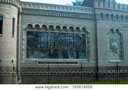 Saint Petersburg, Russia - July 02, 2017: The Museum of Generalissimo Suvorov. Detail of the facade with mosaics depicting the departure of a military commander in a campaign.