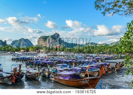 KRABI THAILAND - MAY 4 2015: Tourist boats floating on sea of bay to provide transportation service to tourists to any other islands nearby Krabi Thailand.