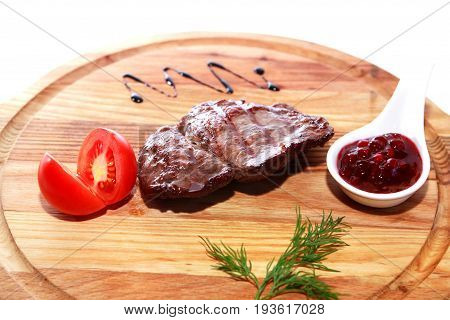 Freshness delicious grilled meat on wooden plate against white background