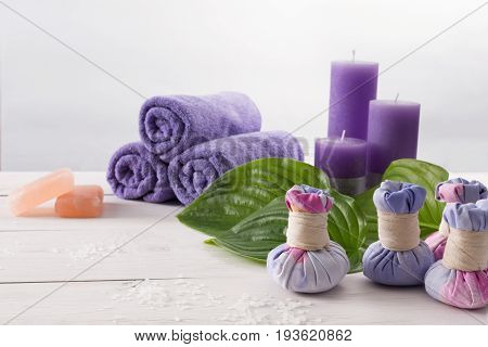 Spa treatment and aromatherapy concept background. Soap, aroma salt, herbal balls for indian spa, candles, details and accessories for wellness beauty parlor. White wood with copy space