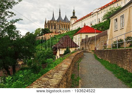 KUTNA HORA CZECH REPUBLIC - JULY 03 2016: Saint Barbara church and rebuild medieval castle wall with tower