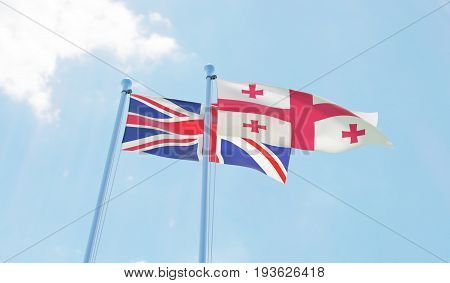 Great Britain and Georgia, two flags waving against blue sky. 3d image