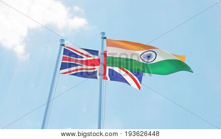 Great Britain and India, two flags waving against blue sky. 3d image