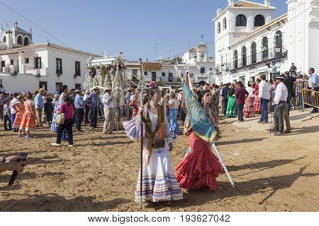 El Rocio Spain - June 2 2017: Pilgrims in traditional flamenco dresses in El Rocio during the pilgrimage Romeria 2017. Province of Huelva Andalusia Spain