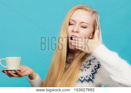 Sleepy Woman Holding Cup Of Coffee