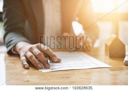 Real Estate Agent With House Model Hand Putting Signing Contract,have A Contract In Place To Protect