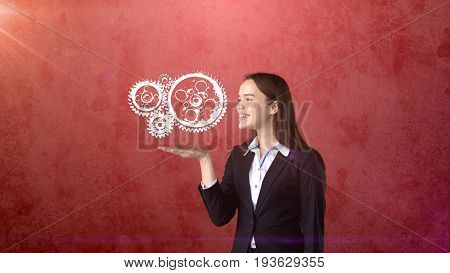 Portrait Of Woman Holding Painted Watch Mechanism On The Open Hand Palm, Isolated Studio Background.