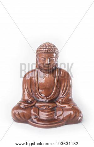 Buddha figure isolated on white background vertical frame.