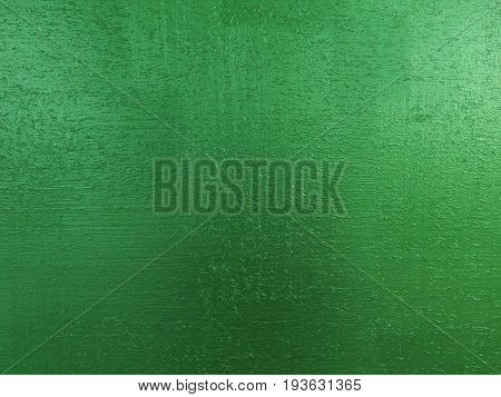 Green emerald stone background texture wooden sawdust particles like scratches. Brush painted wood surface. Green ice pattern background. Green texture painted wooden wallpaper Green ice color surface