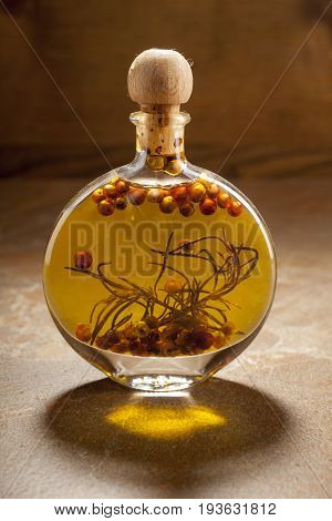Bottle Extra Virgin Olive Oil With Spices On A Ceramic Background