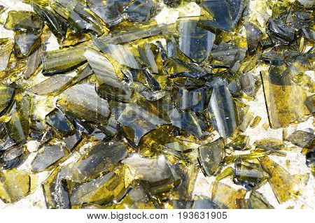Brown and yellow broken glass in the rays of the bright sun