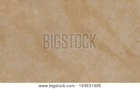 A simple sandy coloured background with a veined effect