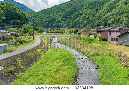 Countryside Landscape With River And Green Grass