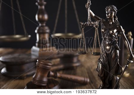 Justice concept, Themis, gavel and scale on wooden table.