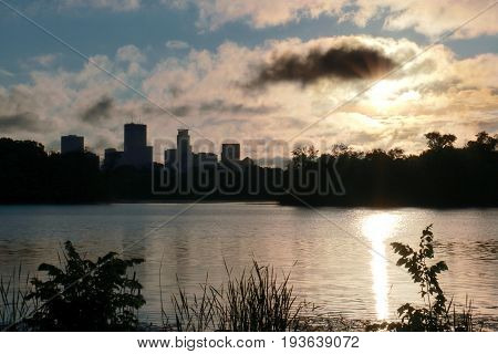 Sunrise over Lake of the Isles with Minneapolis Skyline in Silhouette