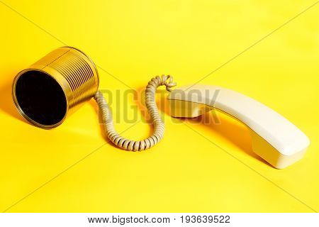 Tin Can Phone With Handset On Yellow Background