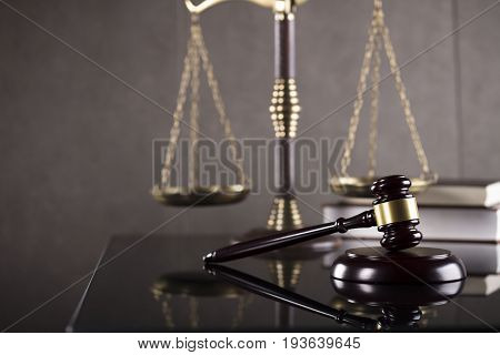 Law concept, gavel, scale of justice and lawyer's books.