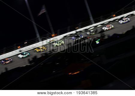 July 01, 2017 - Daytona Beach, FL, USA: Denny Hamlin (11) leads the pack during the Coke Zero 400 at Daytona International Speedway in Daytona Beach, FL.