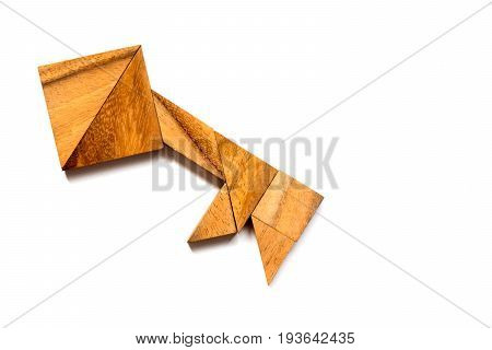 Wooden tangram puzzle in key shape on white background (Concept of data security authorized access safety)