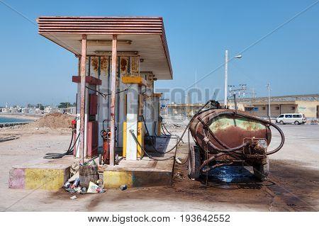 Hormuz Island Hormozgan Province Iran - 17 april 2017: A rusty tank stands near a small petrol station.