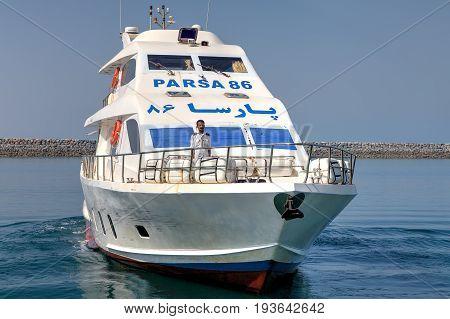 Hormuz Island Hormozgan Province Iran - 17 april 2017: Passenger ferry from the island of Hormuz to Bandar Abbas departs from the pier.