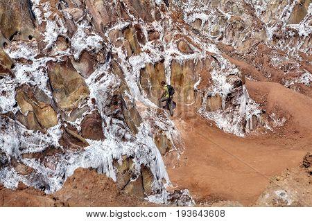 Hormuz Island Hormozgan Province Iran - 17 april 2017: Iranian Island of Hormuz in Persian Gulf The tourist looks at the crystals of salt in the salt mountains.