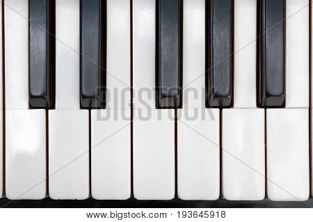 Ancient piano ivory keys close up. Top view