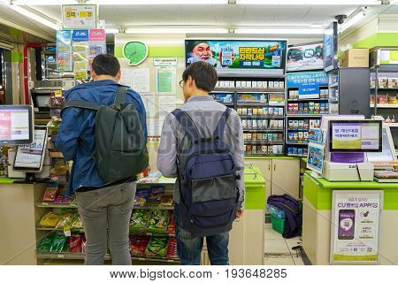 SEOUL, SOUTH KOREA - CIRCA MAY, 2017: men at a CU convenience store. CU is a convenience store franchise chain in South Korea.