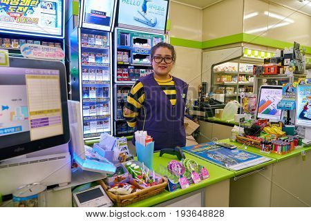 SEOUL, SOUTH KOREA - CIRCA JUNE, 2017: worker at CU convenience store. CU is a convenience store franchise chain in South Korea.