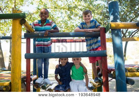 Portrait of happy friends on enjoying on jungle gym at playground