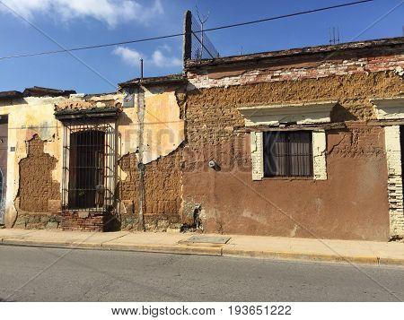 OAXACA, OAXACA, MEXICO- JUNE 17, 2017: Abandoned house made of adobe on a street in Oaxaca, Mexico